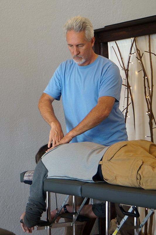 Chiropractor Schmelzle with patient